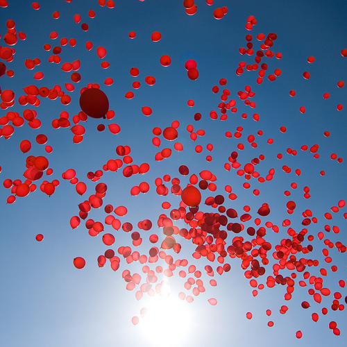 Red balloons in flight